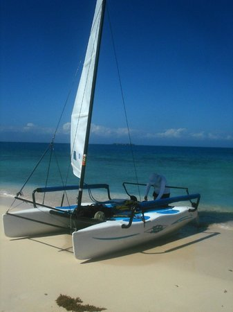Hatchet Caye Resort:                   Hobie on the beach at Silk Cayes