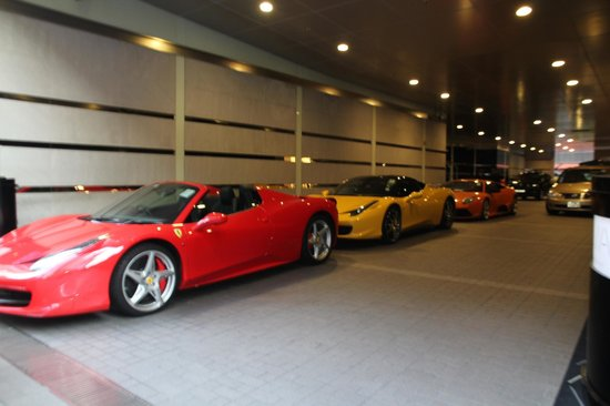 Hotel Panorama by Rhombus: exotic cars parked out front of hotel