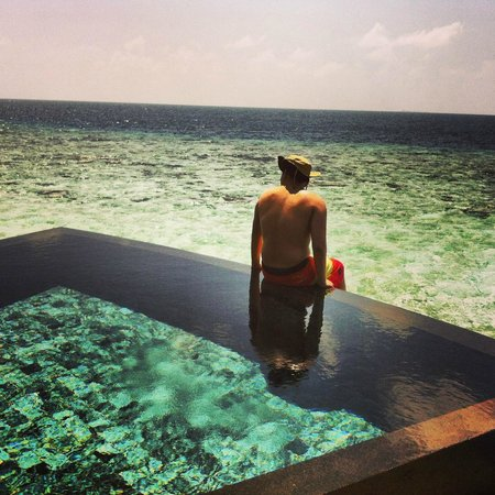 Constance Halaveli:                   Yours truly at the infinity plunge pool admiring the infinity sea.