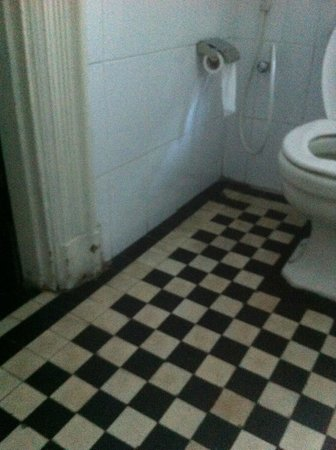 Queen's Hotel:                   beautiful old floor tiles (in need of refurb, cleaning) and chipped paintwork