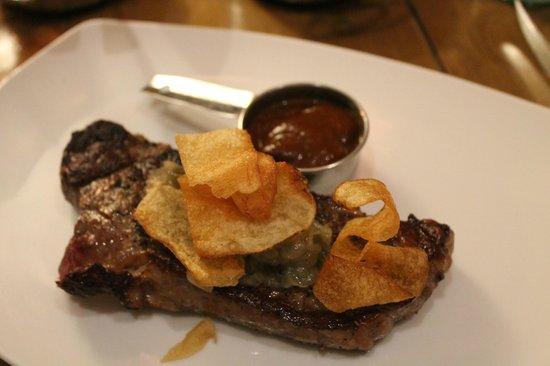 1808 Grille:                   New York strip steak potato chips