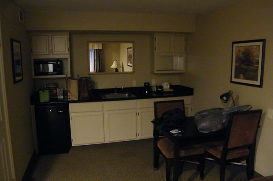 BEST WESTERN Plus Meridian Inn & Suites, Anaheim-Orange: kitchen area... none of the cabinets work.. glued shut and a kitchen chair had disgusting stain