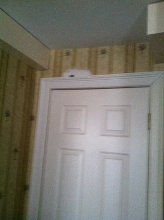 The Pines Inn of Lake Placid:                   patches over closet door