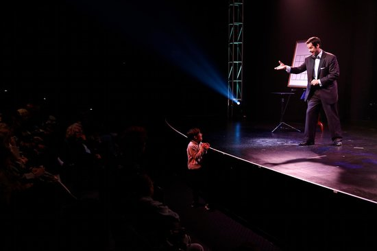 San Francisco Magic Show: A young audience member gets to perform a trick!