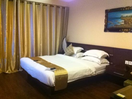 Devata Suites and Residence:                                     big bed