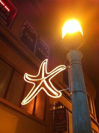Tora Sushi Lounge: outside at night :)