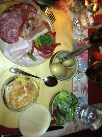 Le Chalet du Coucou:                   Charcuterie and baked cheese with potatoes! about Euro 19.50