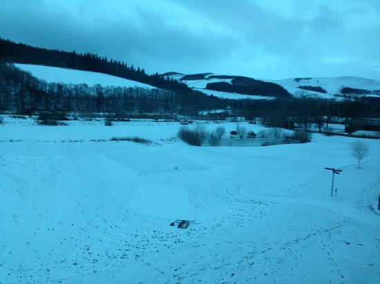 Macdonald Cardrona Hotel, Golf & Spa:                   View from bedroom late afternoon and snow falling.