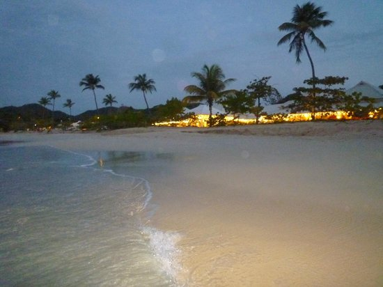 Spice Island Beach Resort: View of resort from beach in the evening