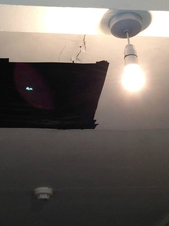 Boundary Hotel:                                     Hole in the ceiling covered by a bin bag- VILE