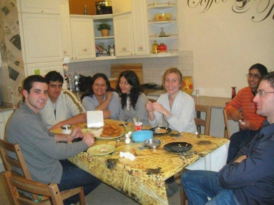 Njoy Budapest Hostel:                   Hanging out in the kitchen; friends from Brazil, Poland, France and USA -