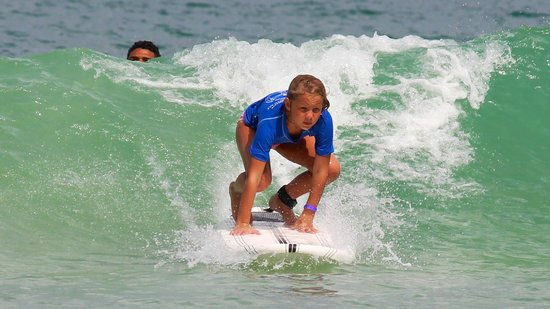Macao Surf Camp:                   She's UP!!! And you can see the staff behind the wave!