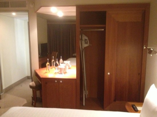 Hilton London Heathrow Airport: Closet (no light) and dated furnishings