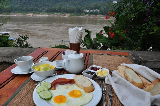 The BelleRive Boutique Hotel:                   breakfast by the Mekong River