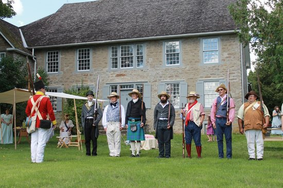 Maitland, Canada:                   The 1st Grenville Militia drilling in front of historic Homewood Museum