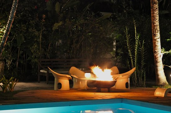 Pousada Picinguaba:                   Poolside fire by night.