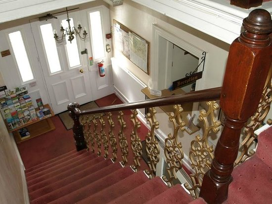 Rock House Bed and Breakfast:                   Hallway with grand staircase