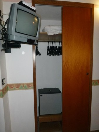 Hotel Giuliana:                   Room closet, TV & mini Fridge