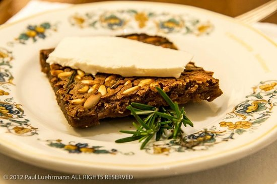 Cantinetta Antinori:                                     Castagnaccio - chestnut flour cake with Ricotta cheese