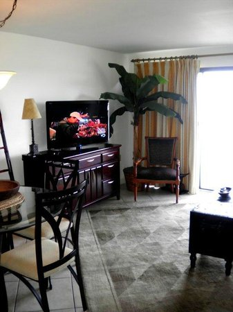 Forest Dunes Resort:                   living room and sliding glass door to ocean-view balcony