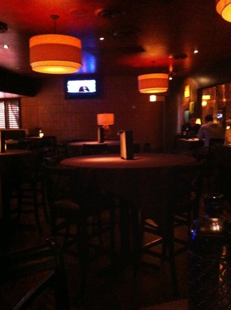 Perry's Steakhouse & Grille: Sitting Area (dimly lit)