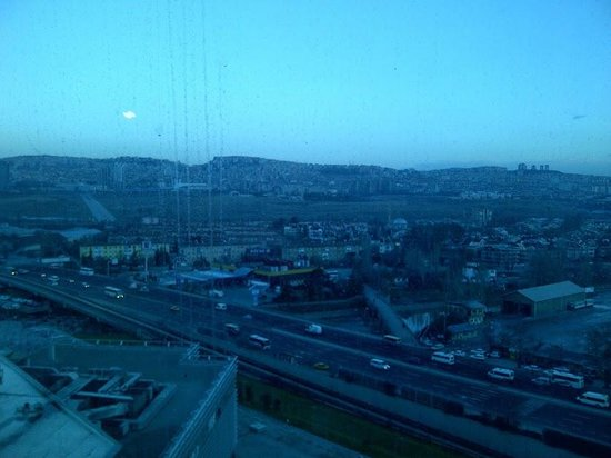 Crowne Plaza Hotel Ankara: View from a room on the 11th floor -- rail line, highway, and smog