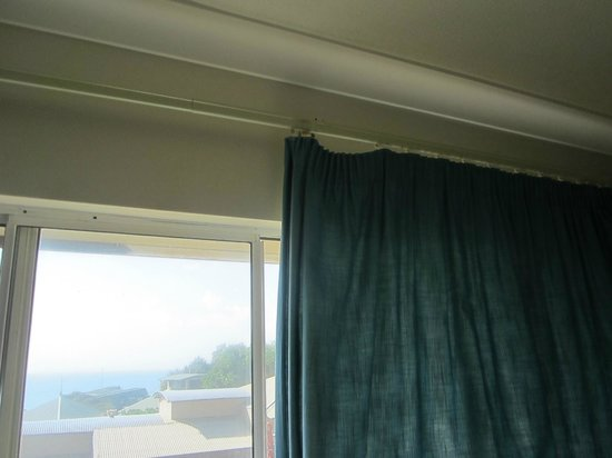 Samarinda:                   Broken curtains in second bedroom