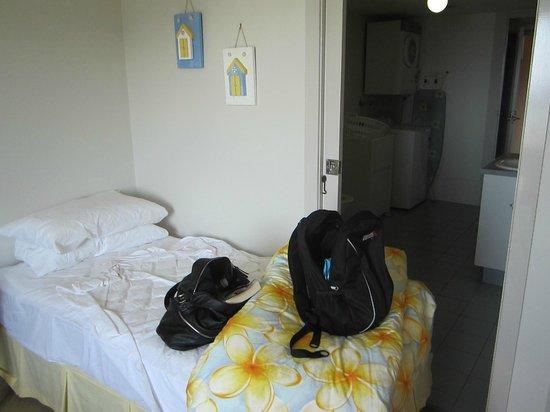 Samarinda:                   Bed shoved up against bathroom door (why?)