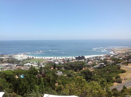 Boutique @ 10:                   picture of camps bay from balcony