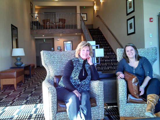 Alpine Inn:                   Guest and manager visit in the new lobby/fireplace area.