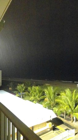 Carousel Resort Hotel & Condominiums:                                     a rainy night view over the beach bar area from our balcony