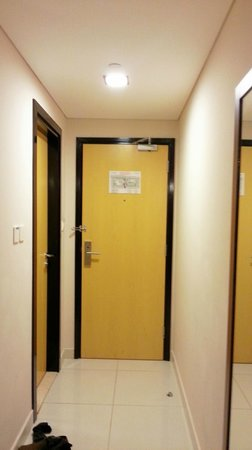 Citymax Hotels Bur Dubai: the room front door and bath door on the left