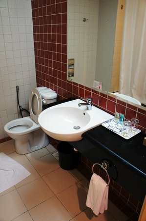 First World Hotel:                   The bathroom with tub/shower