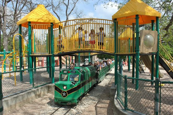 Zilker Zephyr Miniature Train :                   going through the playground