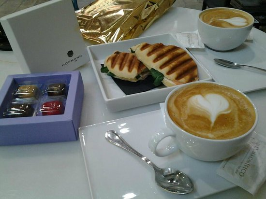 Pastisseria Hofmann:                   coffees with milk, salmon and spinach panini and (insanely delicious) heart sh