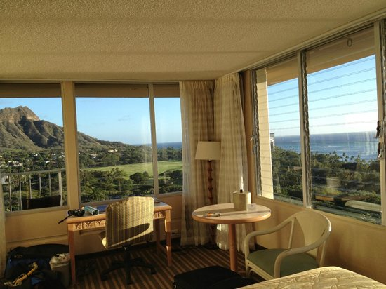 Queen Kapiolani Hotel:                   18th floor from bed, waking up to ocean and Diamond Head!