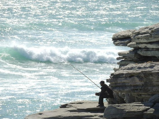 MOSAIC Lagoon Lodge:                   Fisherman on the beach