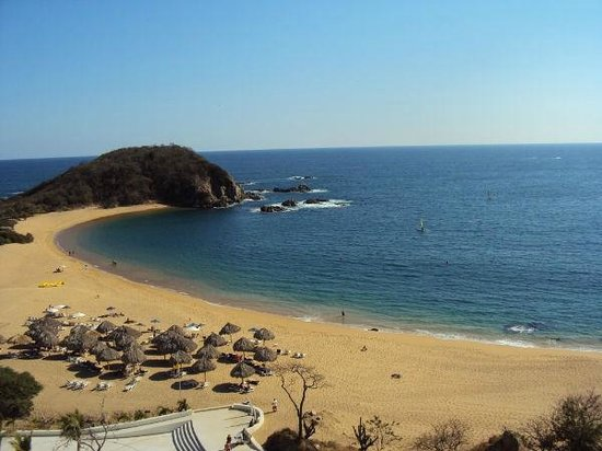 Secrets Huatulco Resort & Spa:                   beach area with umbrellas