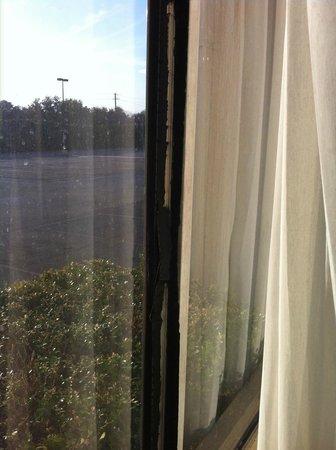 The Regency Hotel :                   Black tape holding window closed