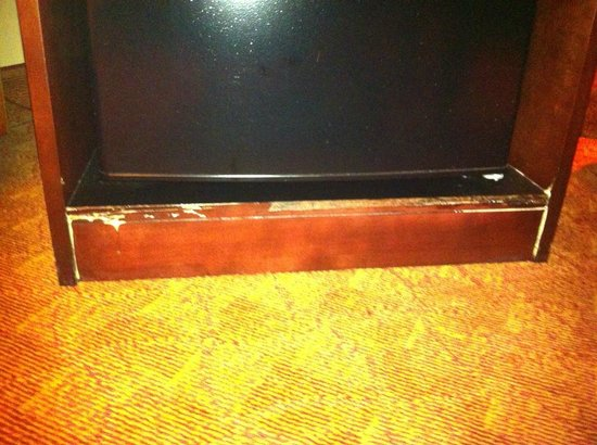Hampton Inn Houston/Humble-Airport Area : cabinet holding the fridge