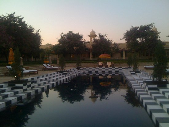 The Oberoi Udaivilas: the hotel's inside pool at sunset