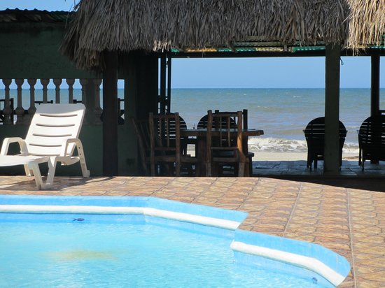 La Delphina Bed and Breakfast, Bar and Grill:                   View from the pool/bar to the beach