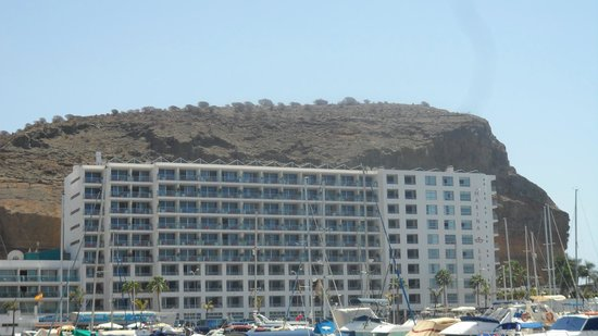 Marina Suites:                   side view of the hotel from other side of the harbour