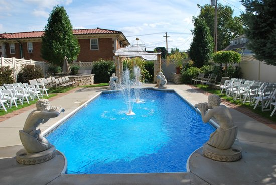 Mishawaka, IN:                   Pool area with wedding set-up.