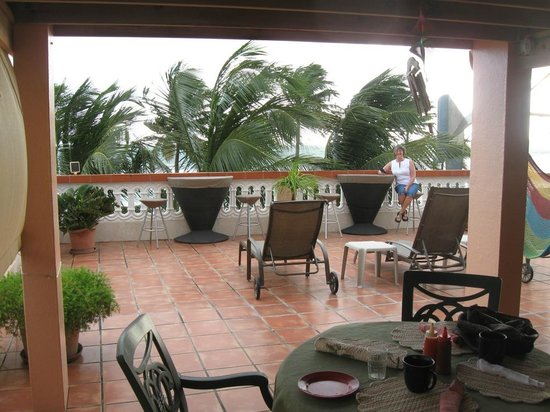 Luquillo Sunrise Beach Inn :                                     Breakfast deck on a stormy day