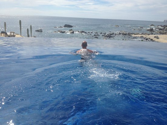 Hacienda Encantada Resort & Residences:                   my husband in the infinity pool overlooking the ocean.  whale watching!