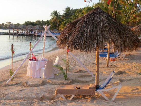 Sandals Negril Beach Resort & Spa:                   Setting up for beach dinner