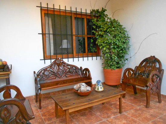 Casa Los Arquitos B&B:                   Seating area right outside our room
