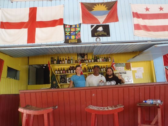 Smiling Harry's:                                     Flags, bottles and one of the best hospitality
