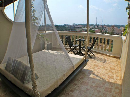 The Privilege Floor by BOREI ANGKOR:                   Romantic swing on patio
